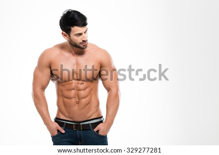 Portrait of a fitness man with nude torso standing isolated on a white background  - stock photo