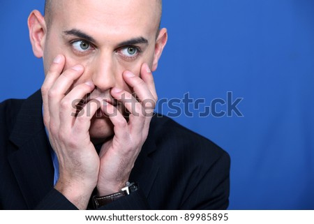 Portrait of a flabbergasted man - stock photo