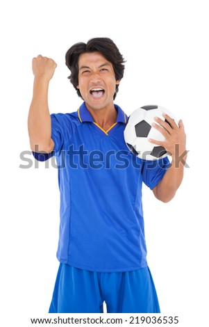 Portrait of a football player cheering over white background