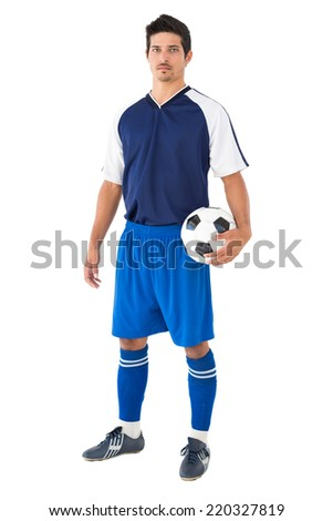 Portrait of a football player standing over white background - stock photo