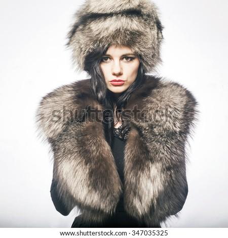 Portrait of a fresh beautiful fashion winter mod - stock photo