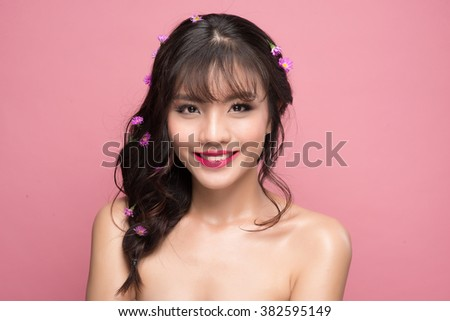 Portrait of a fresh young woman enjoying the smoothness of her skin - stock photo