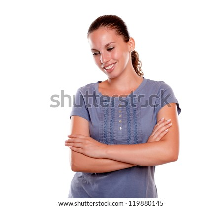 Portrait of a fresh young woman smiling on blue shirt on blue blouse on isolated background - stock photo