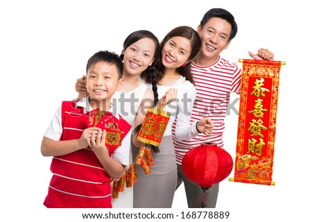 Portrait of a friendly Asian family wishing happiness in the New Chinese Year standing against a white background  - stock photo