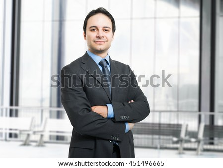 Portrait of a friendly businessman - stock photo