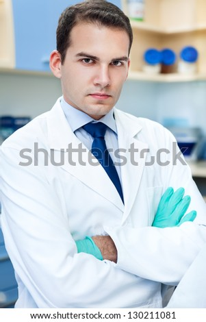 Portrait of a friendly doctor - stock photo