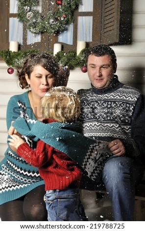 Portrait of a friendly family with pregnant woman during Christmas time - stock photo