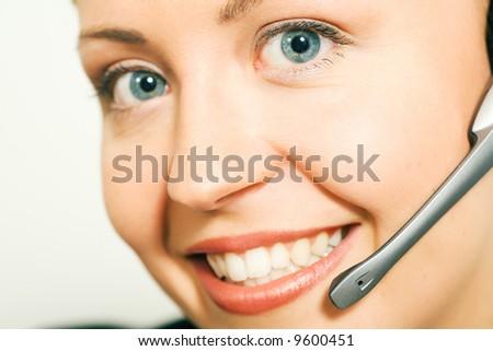 Portrait of a friendly female call center operator - stock photo