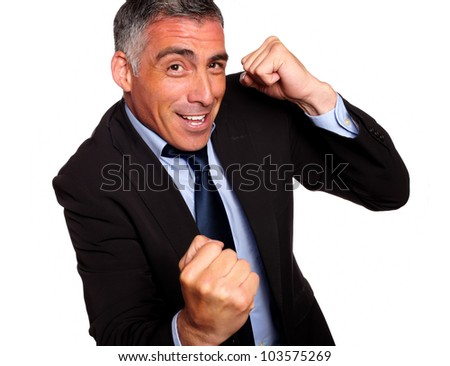 Portrait of a friendly hispanic businessman boxing on isolated background - stock photo