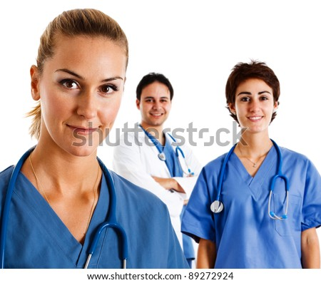 Portrait of a friendly nurse in front of her team - stock photo