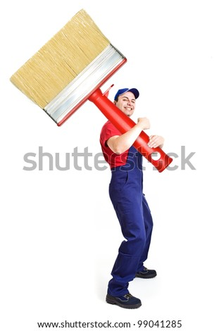 Portrait of a friendly painter holding a big brush - stock photo