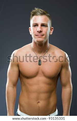 Portrait of a friendly smiling fit young man. - stock photo