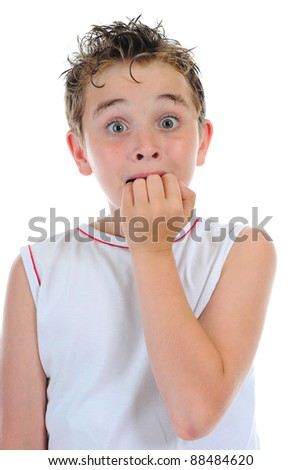 Portrait of a frightened boy. isolated on a white background - stock photo