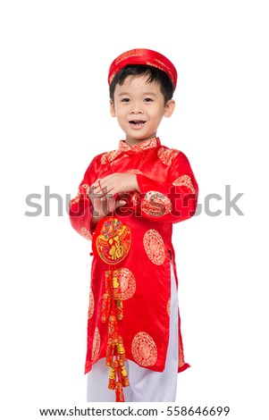 Portrait of a funny and exciting Vietnamese boy with firecrackers. Asian Kid Celebrating New Year. Text mean Happiness.