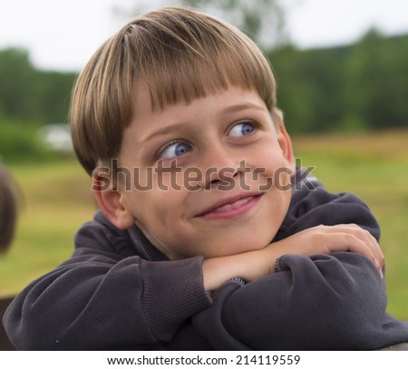 portrait of a funny boy - stock photo