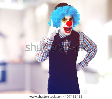 portrait of a funny clown over white - stock photo