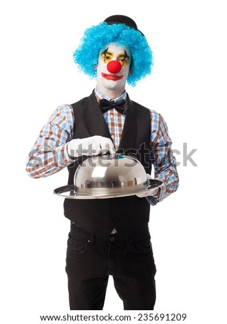 portrait of a funny clown presenting an object
