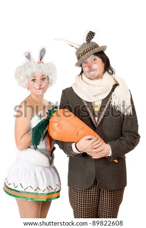 Portrait of a funny couple dressed as rabbits - stock photo