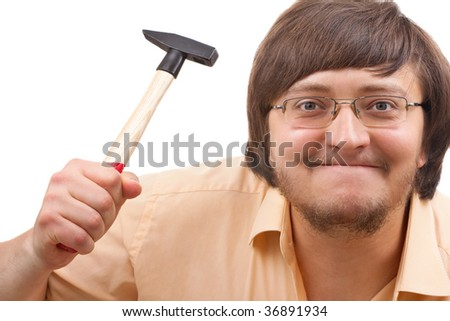 Portrait of a funny crazy guy with a hammer - stock photo