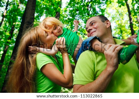 Portrait of a funny family having good time outdoors - stock photo