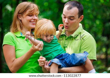 Portrait of a funny family having good time outdoors