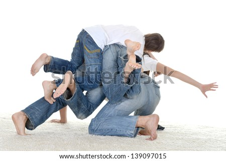 portrait of a funny family of four in white jerseys time together - stock photo