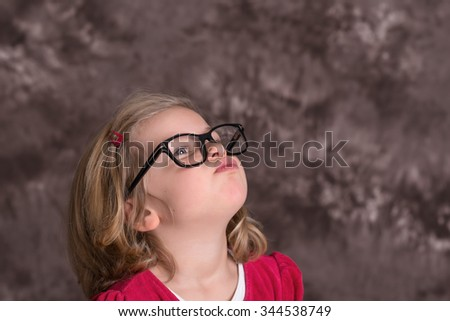 portrait of a funny girl with big glasses - stock photo