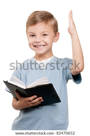 Portrait of a funny little boy holding a book over white background - stock photo