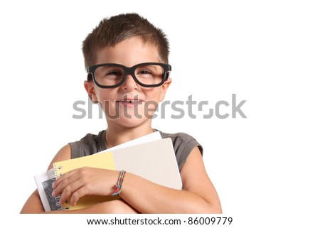 Portrait of a funny little boy holding a exercise books over white background