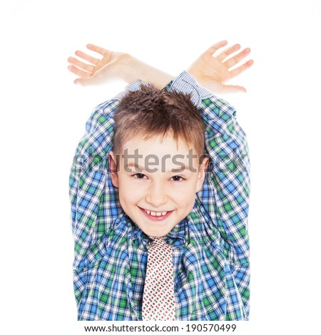 Portrait of a funny little boy making faces. - stock photo