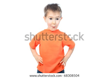 Portrait of a funny little boy making faces. Isolated over white background. - stock photo