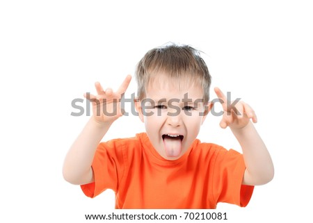 Portrait of a funny little boy making faces. Isolated over white background.