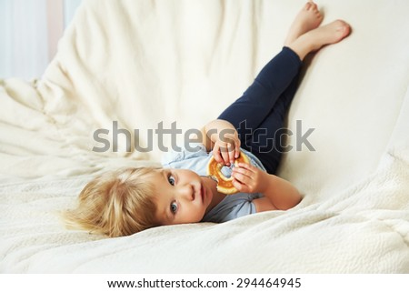 portrait of a funny little girl. child playing at home - stock photo