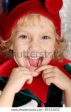 Portrait of a funny little girl in Christmas elf costume.