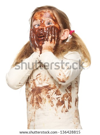 Portrait of a funny little girl with dirty face covered in chocolate isolated on white - stock photo