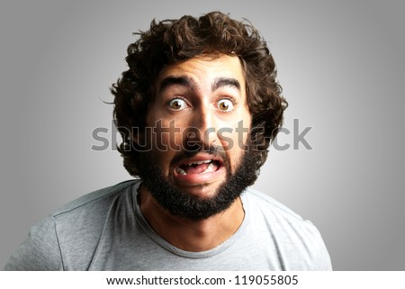 Portrait Of A Funny Man against a grey background - stock photo