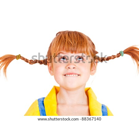 Portrait of a funny red haired girl looking up - stock photo
