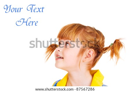 Portrait of a funny red haired little girl looking up - stock photo