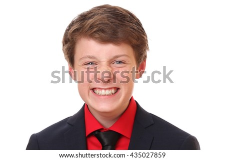 Portrait of a funny teenage boy wearing a suit on white background - stock photo