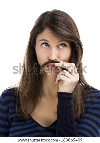 Portrait of a funny woman making a moustache with her own hair - stock photo