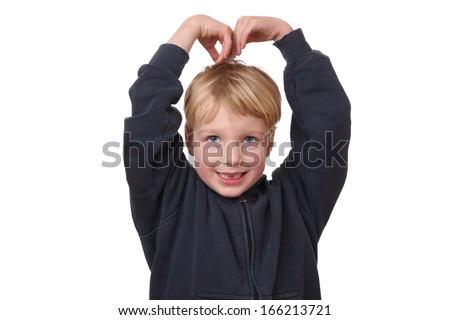 Portrait of a funny young boy with hands on his head on white background - stock photo