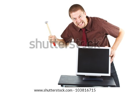 Portrait of a furious man with a hammer about to destroy his monitor - isolated on white - stock photo
