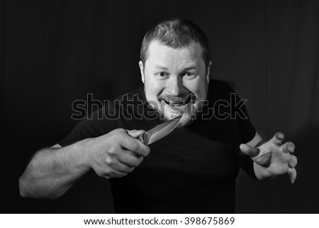 Portrait of a gangster with a knife