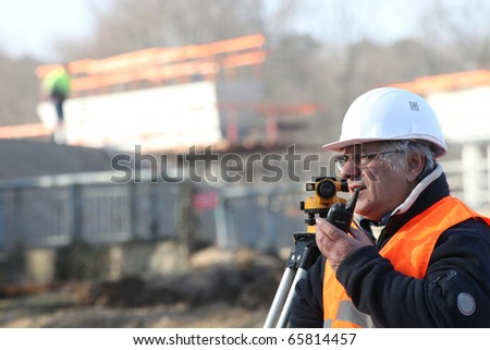 Portrait of a Geometer with a walkie-talkie - stock photo