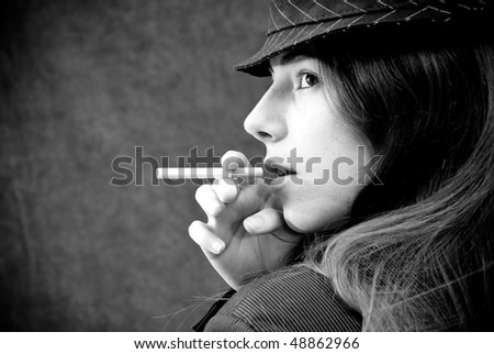 Portrait of a Girl and a Cigarette - stock photo