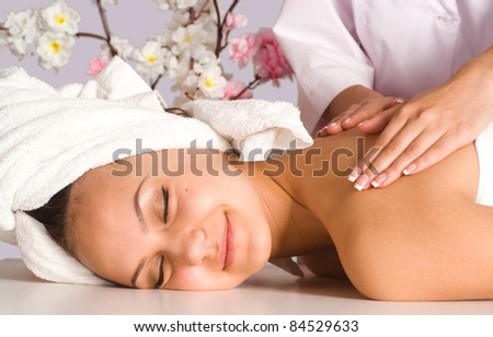 portrait of a girl at body massage - stock photo