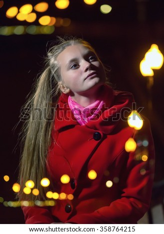 Portrait of a girl at night with lanterns. Multiple exposure - stock photo