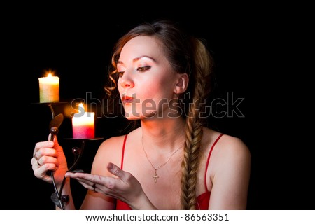 portrait of a girl candle lights a match on New Year's night