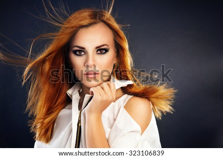 Portrait of a girl close-up hair flying - stock photo