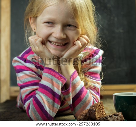 portrait of a girl. cup and cookies - stock photo